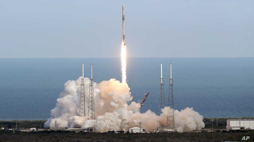 A SpaceX Falcon 9 rocket lifts off from launch complex 40 at the Cape Canaveral Air Force Station in Cape Canaveral, Florida, April 2, 2018.
