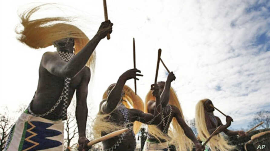 Members of  traditional Rwandan dance troupe perform in London 8 Mar 2010 on day Rwanda was accepted into Commonwealth