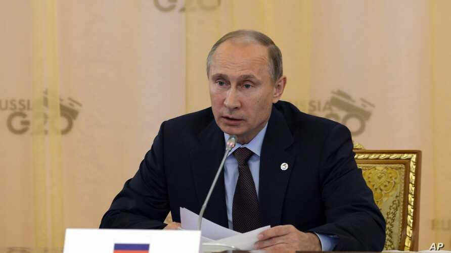 Russia's President Vladimir Putin speaks during a working session at a G-20 summit in St. Petersburg, Russia, Sept. 6, 2013.