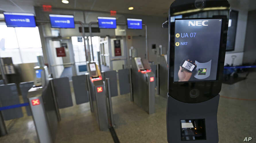 FILE - A U.S. Customs and Border Protection facial recognition device is ready to scan another passenger at a United Airlines gate.