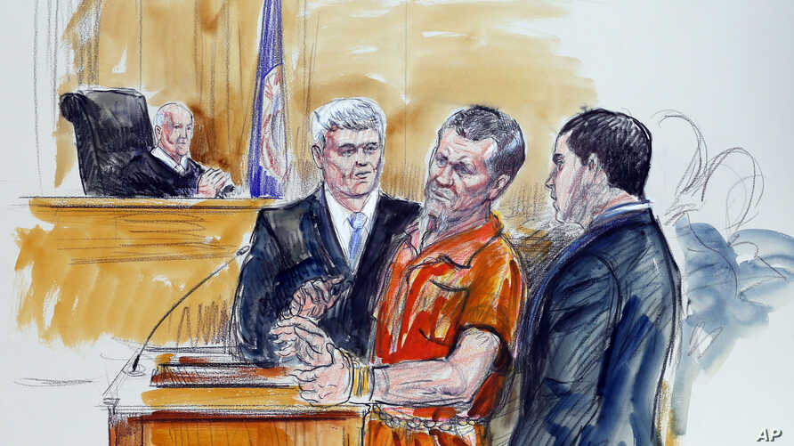 File - Artist rendering shows Irek Hamidullin, front center, his attorney Robert Wagner, front left, and interpreter Ihab Samra, front right, as judge Henry Hudson, left, listens in Federal Court in Richmond, Virginia.