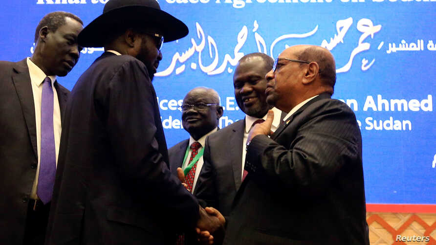 South Sudan President Salva Kiir, Sudan's President Omar Al-Bashir and South Sudan rebel leader Riek Machar talk after signing a peace agreement aimed to end a war in which tens of thousands of people have been killed, in Khartoum, Sudan, June 27, 20
