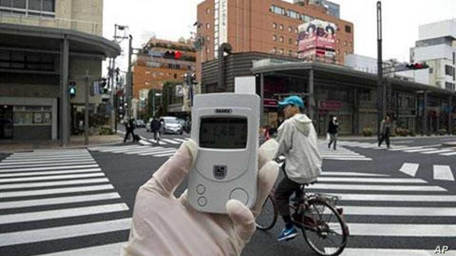 A Greenpeace radiation expert monitors the radiation near Namie village, 40 kms from the stricken Fukushima Dai-Ichi nuclear plant, April 8, 2011
