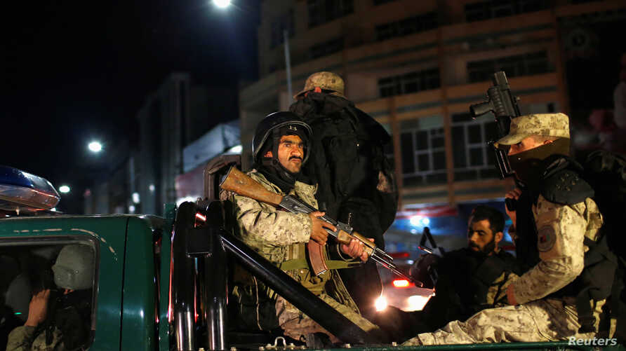 Afghan security personnel arrive near the Serena hotel, during an attack in Kabul, March 20, 2014.