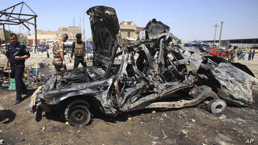 Iraqi security forces inspect the site of a car bomb attack in Basra, 340 miles (550 kilometers) southeast of Baghdad, Iraq, Sept. 15, 2013.