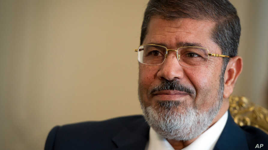 Mohammed Morsi sitting in Ittihadiya Palace, the official residence of the President, in Heliopolis, a suburb of Cairo. (photo from 10/07/12).