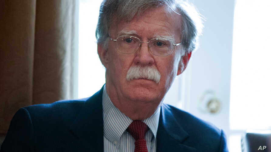 FILE - National Security Adviser John Bolton listens as President Donald Trump speaks during a cabinet meeting at the White House in Washington, April 9, 2018.