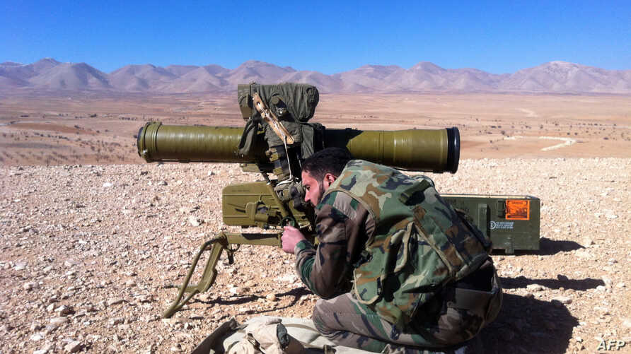 A pro regime soldier aims a rocket launcher towards rebel locations in the Qalamoun region on the outskirts of the Syrian capital Damascus on February 13, 2014. More than 136,000 people have been killed in Syria's nearly three-year war, and millions