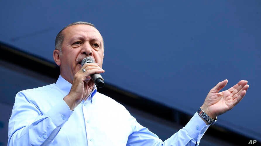 Turkey's President Recep Tayyip Erdogan, addresses supporters of his ruling Justice and Development Party (AKP) during a rally in Nigde,  June 11, 2018. Turkey holds presidential and parliamentary elections on June 24, 2018.