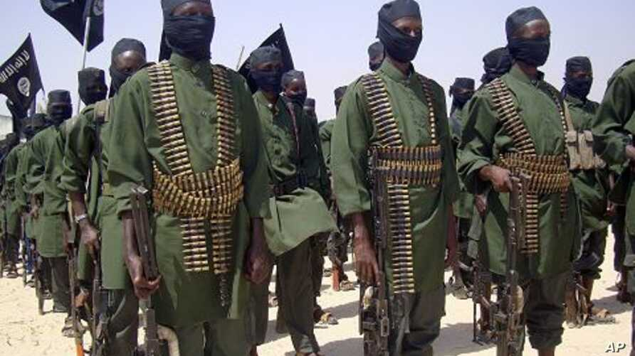 Al-Shabab fighters on parade during military exercises on the outskirts of Mogadishu (File Photo)