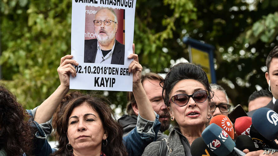 FILE - President of Human Right Association (IHD) Eren Keskin (R) speaks to journalists during a demonstration in front of the Saudi Arabian consulate in Istanbul, in support of missing journalist and Riyadh critic Jamal Khashoggi, Oct. 9, 2018.