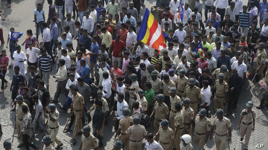 Protesters march during a strike called by Dalit groups in Mumbai, Jan 3, 2018.