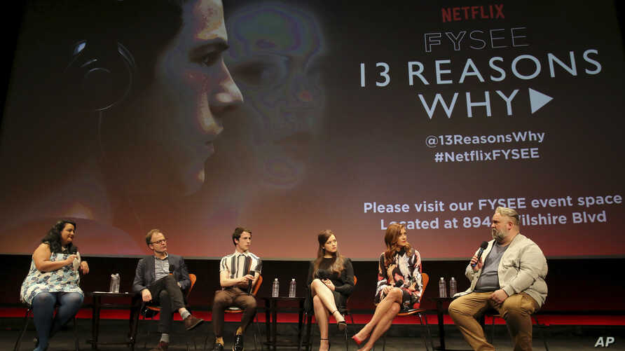 """FILE - Jenelle Riley, director Tom McCarthy, Dylan Minette, Katherine Langford, Kate Walsh and executive producer Brian Yorkey talk about Netflix's """"13 Reasons Why"""" at an event at the Samuel Goldwyn Theater, Los Angeles, June 2, 2017."""