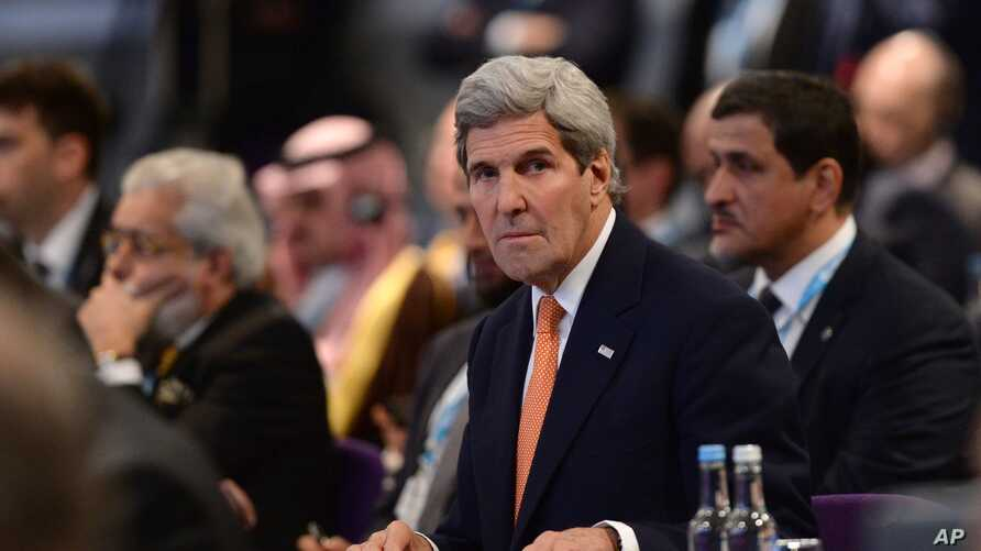 """FILE - U.S. Secretary of State John Kerry attends the """"Supporting Syria and the Region"""" conference in London, Feb. 4, 2016. Kerry said Sunday the """"path to peace"""" in Syria is """"actually right in front of us now."""""""