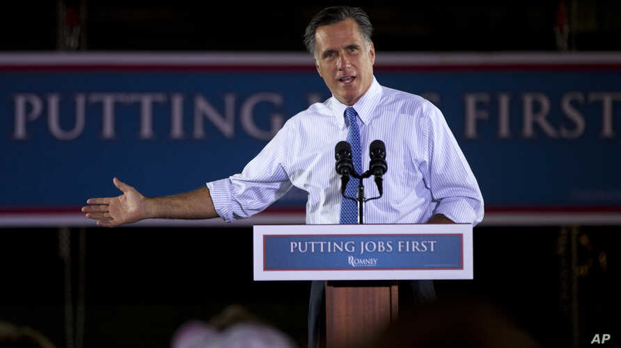 Republican presidential candidate Mitt Romney gestures during a campaign stop at Production Products in St. Louis, Missouri, June 7, 2012.