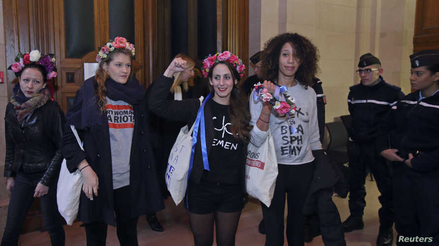 Activists of Ukrainian women's rights group Femen leave the Paris courthouse, Oct. 29, 2015, after they were acquitted in appeal over a topless demonstration they staged inside Notre-Dame Cathedral in February 2013.