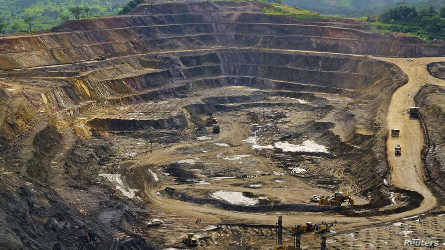 File - Excavators and drillers at work in an open pit at Tenke Fungurume, a copper and cobalt mine 110 kilometers northwest of Lubumbashi in Congo's copper-producing south, owned by miner Freeport McMoRan, Lundin Mining and state mining company Gecam