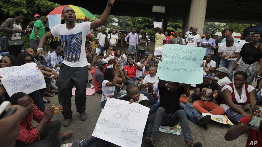 People  attend a demonstration calling on  government to rescue kidnapped school girls of a government secondary school Chibok, during workers day celebration in Lagos, Nigeria. Thursday, May, 1. 2014, Scores of girls and young women kidnapped from a...