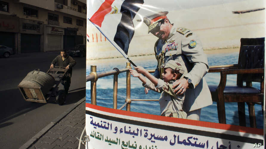 A poster showing Egyptian President Abdel-Fattah el-Sissi, is displayed in Tahrir Square, which was the focal point of the Jan. 25, 2011 Egyptian uprising, in Cairo, March 22, 2018.