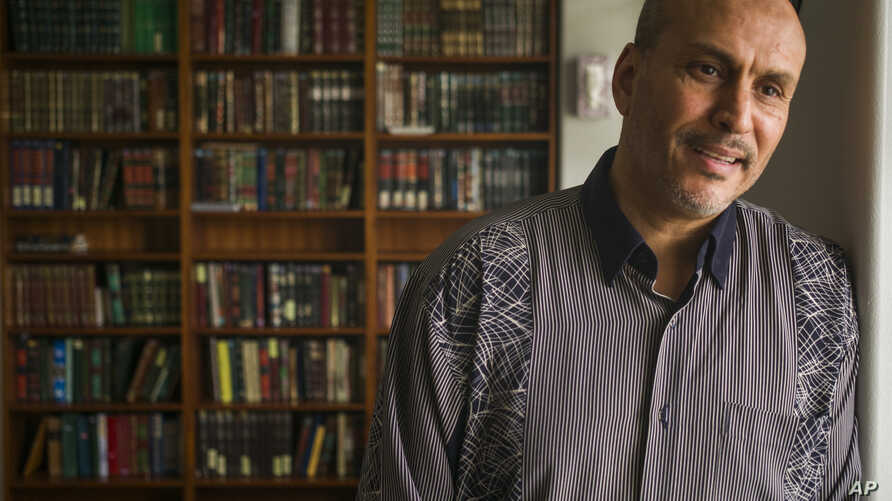 Hakim Ouansafi, president of the Muslim Association of Hawaii, speaks about an amended lawsuit filed by the Hawaii attorney general, during an interview in the library room of the association's mosque, March 9, 2107, in Honolulu.