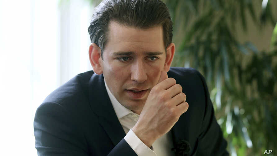 """FILE - Austrian Foreign Minister Sebastian Kurz, pictured during an AP interview, March 17, 2017, says it's """"high time for a focus on pragmatic and practical steps for confidence-building as well as a resumption of substantive negotiations"""" on Nagorn"""