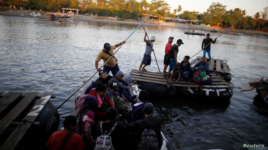People belonging to a caravan of migrants from Honduras en route to the United States, cross the Suchiate river to Mexico from Tecun Uman, Guatemala, Jan. 18, 2019.