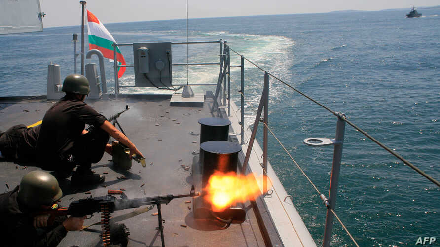 Bulgarian marines fire machine guns on board a Bulgarian navy frigate ship during BREEZE 2014 military drill in the Black Sea, July 11, 2014.