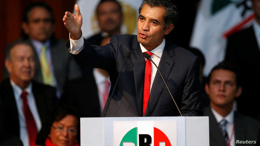 FILE -  Enrique Ochoa delivers a speech after becoming the new chairman of the Institutional Revolutionary Party (PRI), at PRI headquarters, in Mexico City, Mexico, July 12, 2016.