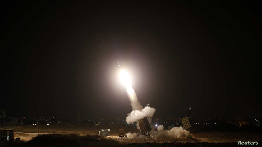 FILE - An Iron Dome launcher fires an interceptor rocket in the southern Israeli city of Ashdod.