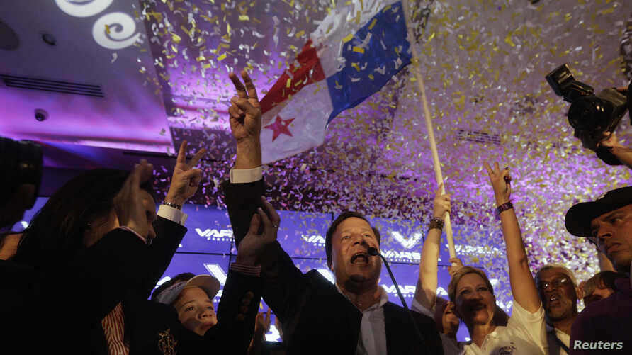 Juan Carlos Varela, presidential candidate for the Panamenista Party (PP), gestures after the official election results were released, in Panama City, May 4, 2014.