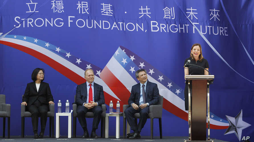 US Assistant Secretary of State for Education and Culture Affairs Marie Royce, right, delivers a speech during the dedication ceremony of the American Institute in Taiwan (AIT) new office complex, the de facto embassy, in Taipei, Taiwan, June 12, 201