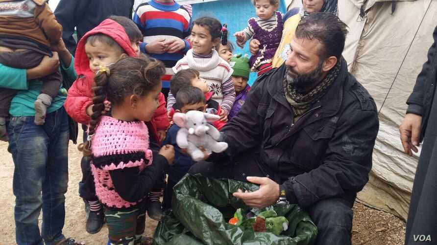 Rami Adham delivers toys to Syrian children in a refugee camp near the war-torn city of Aleppo in February 2016. (photo courtesy of Rami Adham)