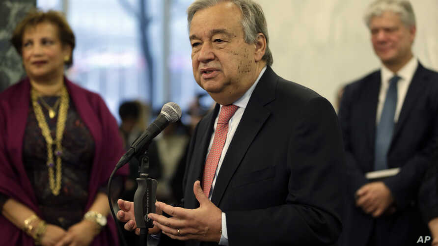 United Nations Secretary-General Antonio Guterres talks with members of the U.N. staff at U.N. headquarters, Jan. 3, 2017.
