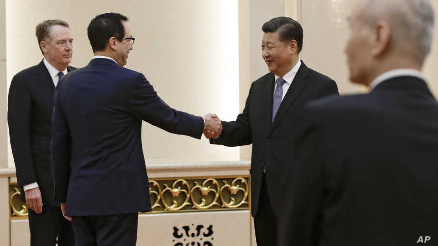 U.S. Treasury Secretary Steven Mnuchin, second from left, shakes hands with Chinese President Xi Jinping as U.S. Trade Representative Robert Lighthizer, left, and Chinese Vice Premier Liu He, right, look on before their meeting at the Great Hall of t
