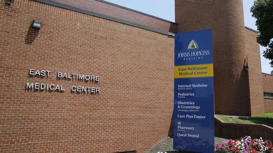 This July 8, 2014, photo shows the East Baltimore Medical Center, an affiliate of Johns Hopkins Hospital in Baltimore. Dr. Nikita Levy worked at the center when allegations he videotaped his female patients during pelvic exams came to light.