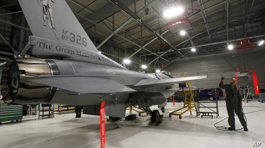 FILE - A U.S. F-16 fighter jet is seen in a hangar in South Burlington, Vermont, Dec. 17, 2012.
