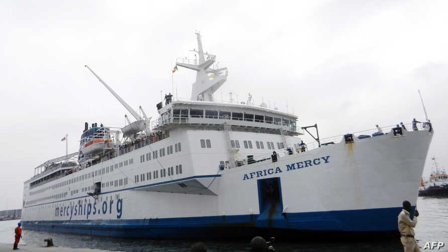 FILE - A picture taken on Aug. 10, 2013 shows the Mercy Africa hospital ship docked at the port in Pointe-Noire.