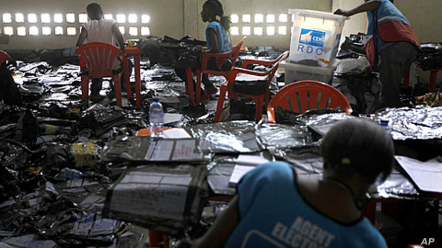 Election volunteers tabulate results at the Fikin compilation center in Kinshasa, Democratic Republic of Congo. Congo's influential clergy say they are concerned about violence and unrest two days before the proclamation of results from a contested p