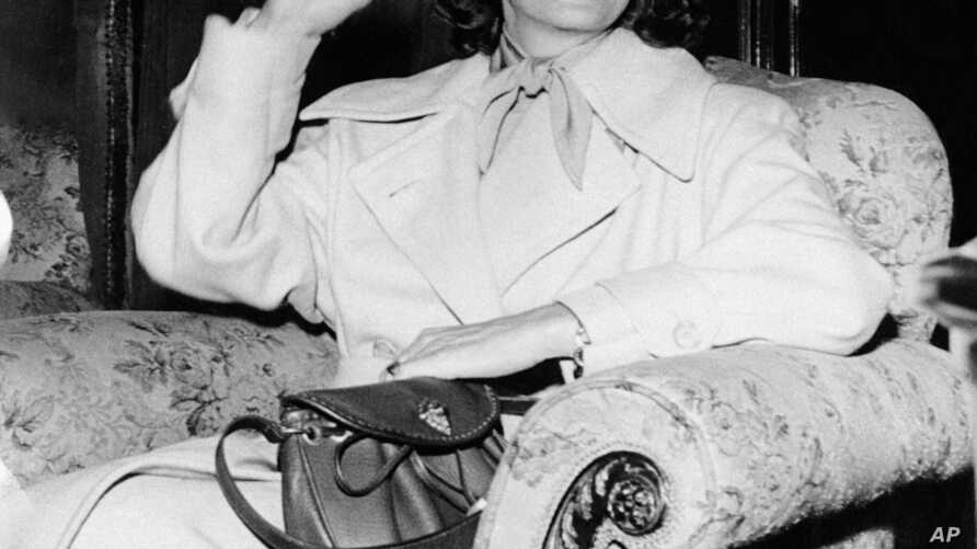 FILE - In this July 17, 1946, file photo, Greta Garbo smiles on her arrival in Gothenburg, Sweden. The New York Times reported that her Manhattan co-op overlooking the East River is on the market for $5.95 million, with monthly maintenance of nearly