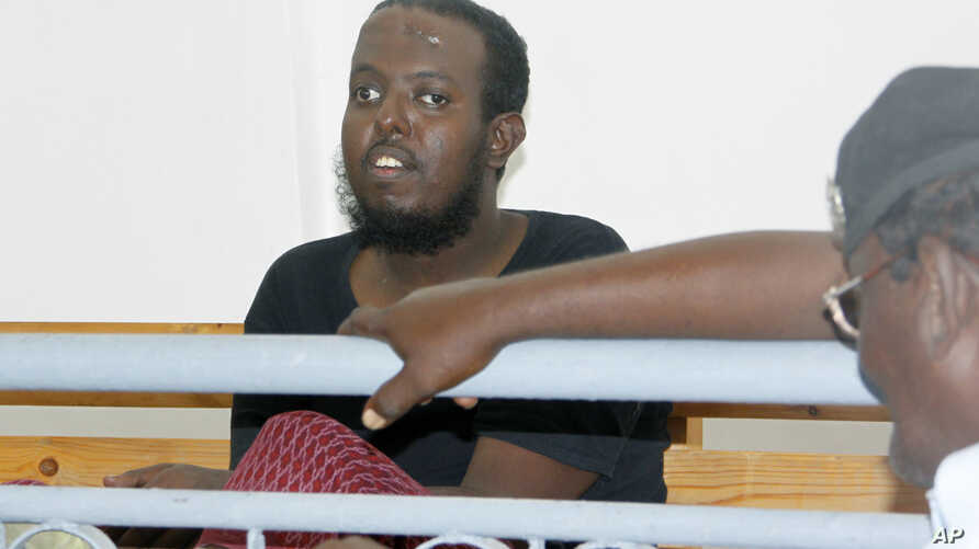 Hassan Hanafi Haji sits inside Mogadishu's military court during a hearing for his alleged role in the killings of Somali journalists, in Mogadishu, Somalia, March, 3, 2016.