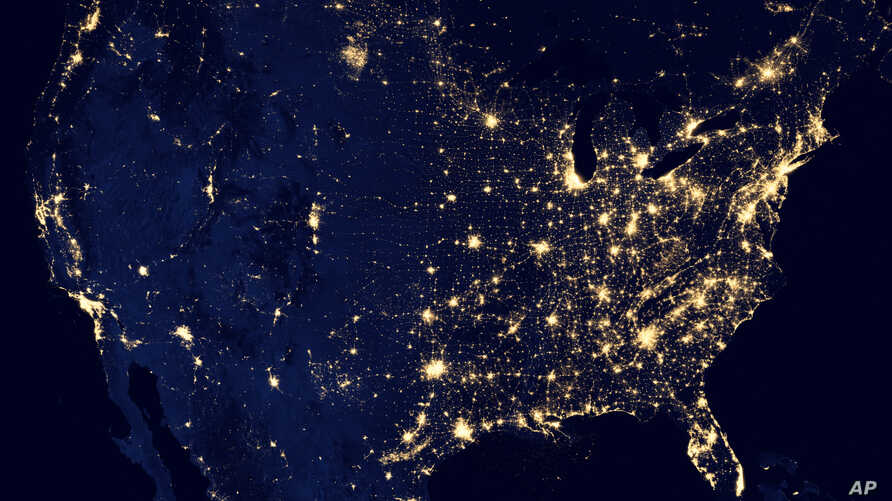 This composite image made available by NASA and assembled by data acquired from the Suomi NPP satellite in April and October 2012 uses the satellite's Visible Infrared Imaging Radiometer Suite (VIIRS), to show the U.S's lights at night.