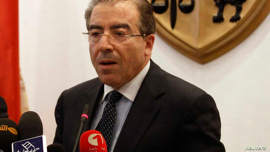 FILE - Tunisia's Foreign Minister Mongi Hamdi speaks during a news conference in Tunis.