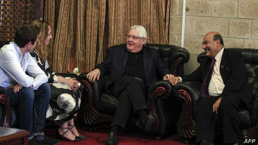 Martin Griffiths, center, the U.N. special envoy for Yemen, is pictured at Sanaa international airport, Nov. 21, 2018.