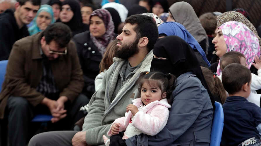 Syrian families await their turn to register at the United Nations High Commissioner for Refugees (UNHCR) center in the northern city of Tripoli, Lebanon, April 3, 2014.