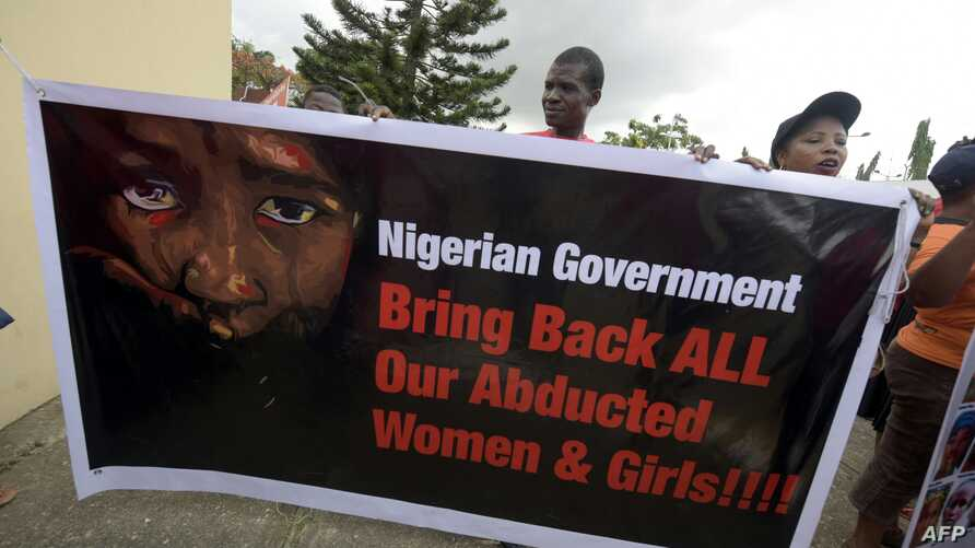 Members of Bring Back Our Girls movement carries banner to press for the release of the missing Chibok schoolgirls in Lagos, on April 14, 2016.