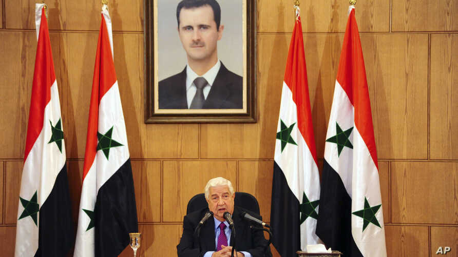 In this photo released by the Syrian official news agency SANA, Syrian Foreign Minister Walid al-Moallem speaks during a press conference in Damascus, Syria, May 8, 2017.