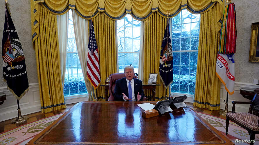 President Donald Trump gestures during an interview with Reuters at the White House in Washington, Jan. 17, 2018.