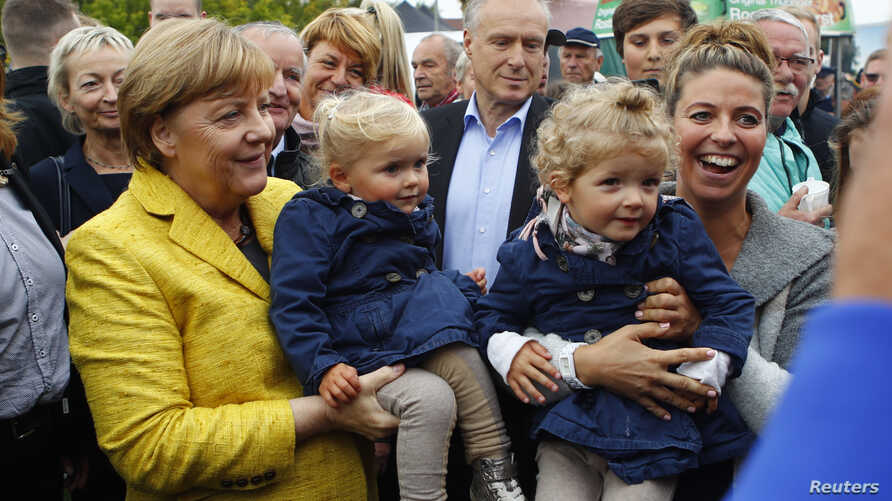 German Chancellor Angela Merkel visits harvest festival in Lauterbach, Germany, Sept. 23, 2017, ahead of the nation's general election on Sept. 24.