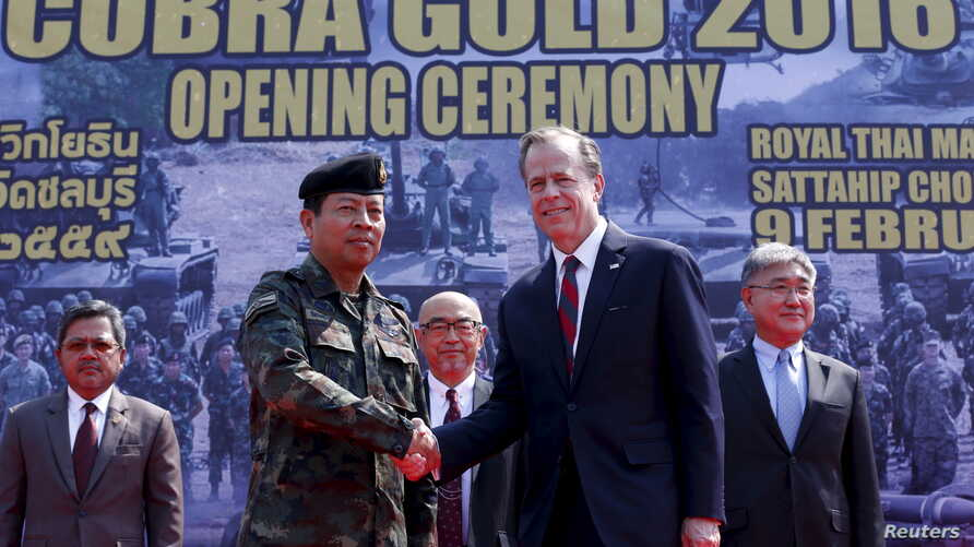 FILE - Royal Thai armed forces General Sommai Kaoteera (left) and U.S. Ambassador to Thailand Glyn Davies shake hands during the opening ceremony for Cobra Gold military exercise in Chonburi, east of Bangkok, Feb. 9, 2016.