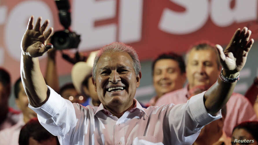 Salvador Sanchez Ceren, the presidential candidate for the Farabundo Marti National Liberation Front (FMLN), waves to his supporters before giving a speech, after the official election results were released, in San Salvador, March 9, 2014.
